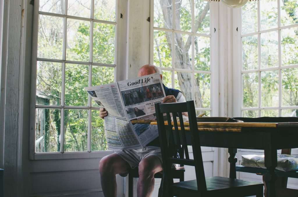 Gentleman Reading Newspaper